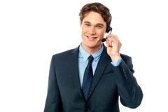 Customer support agent assisting customers Stock Photo