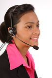Customer support by beautiful female on telephone Stock Photography