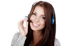 Customer Support girl. With headset smiling during a telephone conversation Stock Photo