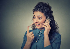 Customer support liar with long nose. Woman talking on mobile phone telling lies. Concept of customer support representative liar with long nose. Portrait young Royalty Free Stock Photos