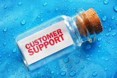 Customer support. Message in a bottle concept for support, assistance and help stock photo
