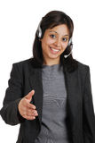 Customer support offering handshake. This is an image of business woman wearing communications headset Royalty Free Stock Photo