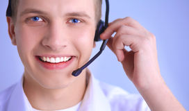 Customer support operator with a headset on white background Royalty Free Stock Photos