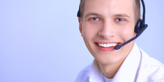 Customer support operator with a headset on white background Royalty Free Stock Images