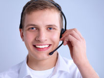 Customer support operator with a headset on white Stock Image