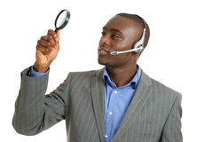 Customer support operator holding magnifying glass Stock Photos