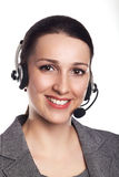 Customer support operator. Woman face.Call center smiling operat. Or with phone headset on white background.Attractive young people working in a call center Stock Photography