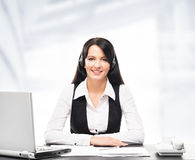 Customer support operator working in a call center office Stock Image