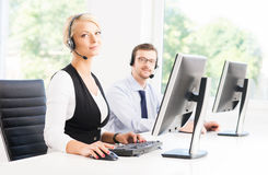 Customer support operators in formalwear working in a call cente Stock Photo