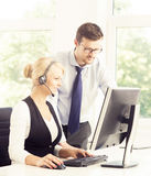 Customer support operators in formalwear working in call center Stock Photos