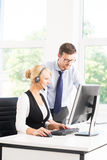 Customer support operators in formalwear working using computers Royalty Free Stock Images