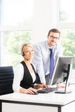 Customer support operators in formalwear working using computers Stock Photo