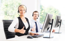 Customer support operators in formalwear working using computers Stock Image