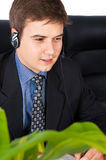 Customer support representative. Friendly customer service representative smiling during a telephone conversation Royalty Free Stock Photo