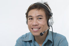 Customer support representative. Asian business man wearing headset and smiling Royalty Free Stock Photo