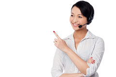 Customer support staff pointing away Stock Image