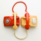 Customer support. Top view of two vintage phones connected with each other by handsets royalty free stock photo