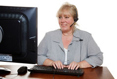 Customer support woman. Mature customer service representative with headset stock image