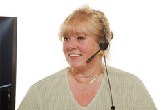 Customer support woman. Mature customer service representative with headset stock images