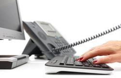 Customer support. A customer support workplace with telephone and computer stock photography