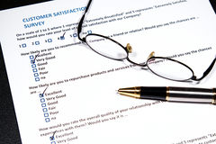 Customer Survey. A survey questionnaire for customer satisfaction with checkboxes stock images