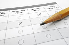 Customer survey form. Survey questionnaire or customer satisfaction form and pencil stock images