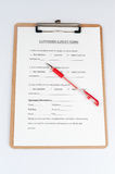 Customer survey form. With a red pen on it Stock Photo