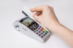 Customer is swiping magnetic credit card in payment terminal.  Royalty Free Stock Images