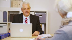 Customer talking to businessman in office stock video footage