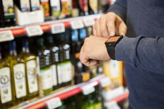 Customer Touching Smartwatchs Screen In Grocery Store Stock Photo