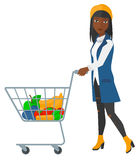 Customer with trolley. An african-american woman pushing a supermarket cart with some goods in it vector flat design illustration isolated on white background royalty free illustration