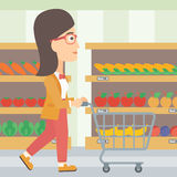 Customer with trolley. Royalty Free Stock Photo
