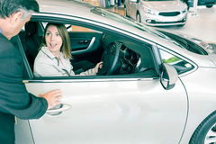 A customer try a car Royalty Free Stock Photo