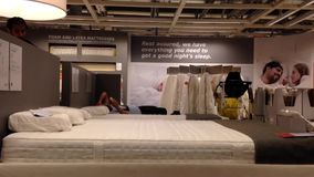 Customer trying new mattress inside Ikea store. In Coquitlam BC Canada stock footage
