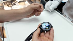 Customer trying Samsung gear s3 smart watch stock video