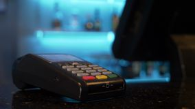 Customer using credit card over pos for cashless contactless payment for shopping. Customer using credit card over pos module for cashless contactless payment stock footage