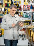 Customer Using Digital Tablet In Hardware Store Stock Image