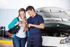 Customer Using Digital Tablet With Mechanic Royalty Free Stock Photos