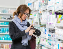 Customer Using Smartwatch In Pharmacy Stock Images