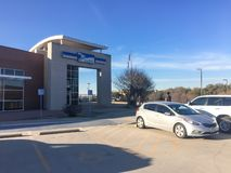 Customer walk in facade entrance of USPS store in Irving, Texas, USA. IRVING, TX, USA-FEB 2, 2018:Customer enter entrance exterior of USPS store winter afternoon royalty free stock image