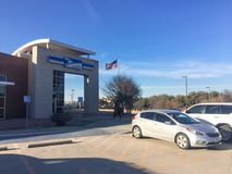 Customer walk in facade entrance of USPS store in Irving, Texas, USA. IRVING, TX, USA-FEB 2, 2018:Customer enter entrance exterior of USPS store winter afternoon royalty free stock photography