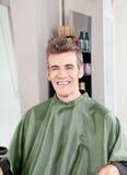 Customer Wearing Apron In Hair Salon Stock Photo