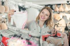 Customer woman in underwear shop Royalty Free Stock Photos