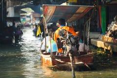 Customer on wooden boat motor Royalty Free Stock Photos
