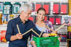 Customer With Worker Holding Folding Ruler In Royalty Free Stock Image
