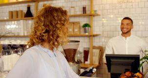 Customer and worker looking at each other 4k. Customer and worker looking at each other at cafe counter 4k stock video