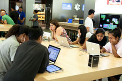 Customers in Apple Store Royalty Free Stock Photos
