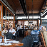 Customers in a bar on Granville Public Market, Vancouver Stock Image