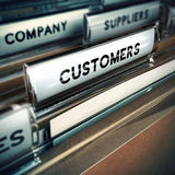 Customers Base or File Concept. Folder tab with focus on the the word customer. Business or clients base concept image with blur effect Stock Photo