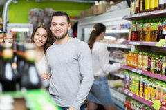 Customers at beverages section of supermarket Stock Photos